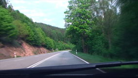 Turn on mountain, forest road stock video footage