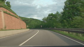Turn on a mountain road stock video footage
