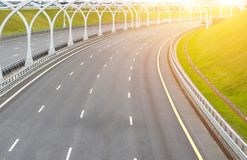 Turn on the multi-lane road without cars. Royalty Free Stock Image