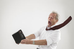 Turn the noise down. Conceptual studio shot over white of an old man being blasted by a sound wave from an audio speaker stock photo