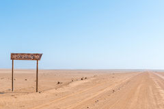 Turn-off from C34-road to rusted oil drilling rig stock photo