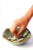 Turn off the cigarette. Fingers turn off the cigarette on green ashtray Royalty Free Stock Photo
