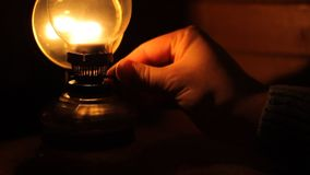 Turn off Gas Lamp. Person is turning of old petrol lamp, in dark room. Suitable for nighttime, dark place, sleep time, symbolic ends stock footage