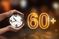 Turn off the light in 60 minute. On blurred light background Royalty Free Stock Photos