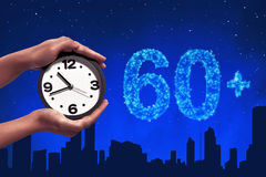 Turn off the light in 60 minute. On sky at night background Stock Photos