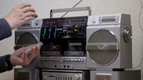 Turn on and turn off the old cassette player stock video