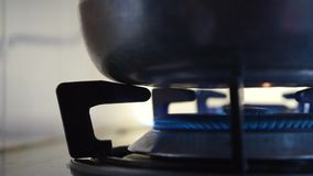 Turn off the stove fire. Turn off the stove fire after cooking the dishes in a pan stock video footage