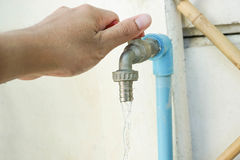 Turn off the tap. Turn the tap off to save water for environment Stock Photo