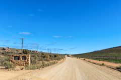 Turn-off to the Maltese Cross and observatory at Dwarsrivier. DWARSRIVIER, SOUTH AFRICA, AUGUST 23, 2018: The turn-off to the Maltese Cross and observatory at stock photography