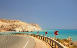 Turn over the beach. A Coastal Highway in Cyprus - Aphrodites rock in  Cyprus Stock Photography