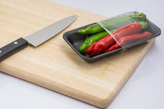 Turn peppers on the chopping block Stock Photo