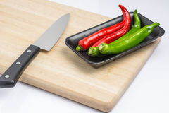 Turn peppers on the chopping block Royalty Free Stock Photo