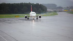 Turn the plane at the airport. The movement of passenger aircraft at the airport in Switzerland, the city of Bern. Rotation on the chassis at 90 degrees. Empty stock video