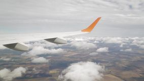Turn the plane in the clouds, filming from the window.  stock video