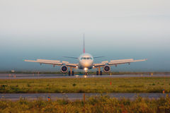 Turn the plane on the runway. In the fog royalty free stock photo