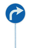 Turn right ahead sign, blue round isolated roadside traffic signage, white arrow icon and frame roadsign, grey pole post Stock Image