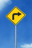 Turn right road sign. Turn right yellow road sign on sky background Stock Photo