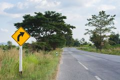 Turn right road sign on country road. stock photos