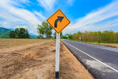 Turn right road sign in the rural area Stock Images