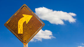 Turn right rusty old signs sky. Royalty Free Stock Images