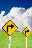 Turn right sign with cloudy sky and nice meadows Royalty Free Stock Photo