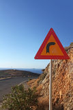 Turn right sign on the mountain road along the coast in Crete Stock Photo