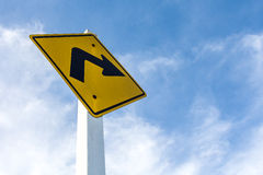 Turn right sign on sky. Turn right yellow road sign on sky background Royalty Free Stock Photos