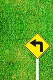 Turn right traffic sign on grass field Stock Photos