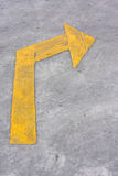Turn Right, Yellow arrow sign on street Stock Photo