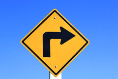 Turn right yellow road sign Stock Image