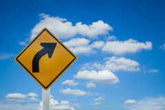 Turn right. Yellow road sign on sky background royalty free stock photo