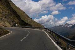 The turn of the road high in the Alps Stock Photography