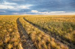 Turn of rural road in steppes Stock Photo