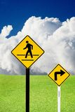 Turn sign and crosswalk sign Stock Photo