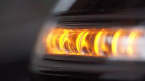 Turn signal light blinking on black car. stock footage