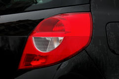 Turn signal and position light. On the black car Stock Photos