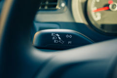 Turn signal seen behind the steering wheel Royalty Free Stock Image