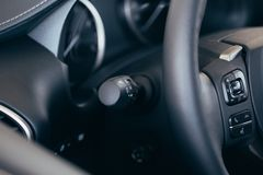 Turn signal switch. Car interior detail royalty free stock images