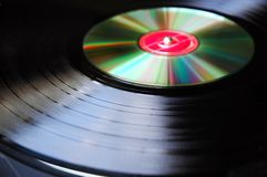 Turn Table. Abstract photo of Vinyl record compared against new technology-Compact Disc on a turn table Stock Image