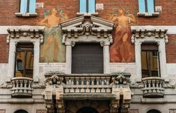 Turn of the 20th century Art Nouveau architecture and humanist wall mural at Milan`s Porta Venezia district, Lombardy, Italy. Milan, Italy - May 24, 2018: Turn royalty free stock image