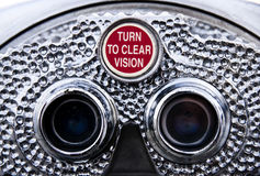 Turn to clear vision - Pay binoculars. Closeup view of pay binoculars. The red knob reads: Turn to clear vision Stock Photo