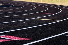 Turn on a Track & Field Course. Black track. Angle shot stock image
