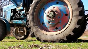 Turn of tractor. The tractor makes a maneuver to the right and moves along the embankment stock footage