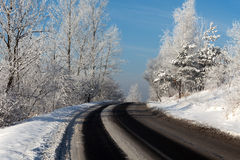 Turn of a winter road Royalty Free Stock Photos