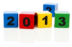 Turn of the year from 2012 to 2013. Alphabet building blocks showing the year 2013, block with number 2 in background Stock Photos