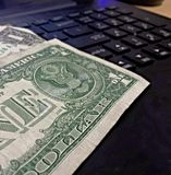 Turn your computer into a money making machine. This is a basic picture of dollar bills representing that you can turn you computer into a money machine online Royalty Free Stock Photo