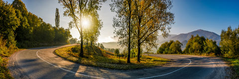 Turnaround on serpentine in countryside area. Bright autumnal sunrise in mountains Royalty Free Stock Image