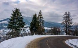 Turnaround on serpentine in winter mountains royalty free stock photos