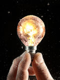 Turned-on bulb under water Royalty Free Stock Photography