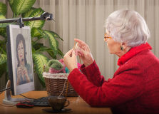 She turned knitting into money Royalty Free Stock Images